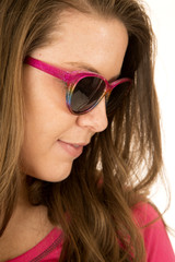 Sideview of a female model wearing sun glasses