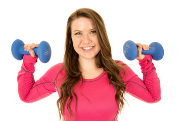 Young brunetter female model lifting barbells happy smiling