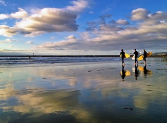 Three Surfers at Dog Beach, Ocean Beach, San Diego, CA, USA