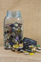 Upright Jar of buttons for nostalgic background