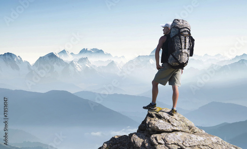 Tourist in mountain peak. Active life concept