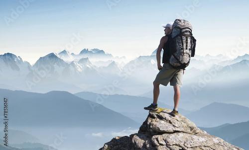 Leinwanddruck Bild Tourist in mountain peak. Active life concept