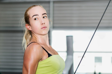 beautiful athletic sporty young girl working out in gym