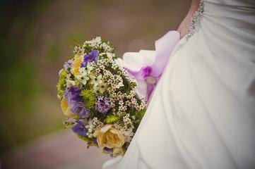 Beautiful wedding bouquet in bride's hand