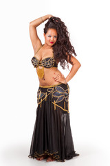 Young belly dancer in black costume