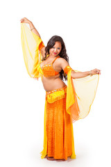 Young belly dancer in yellow and orange costume
