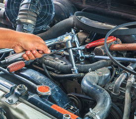 Engine mechanic working at auto repair shop