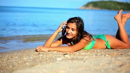 Pretty woman talking on the phone at beach. Koh Samui. Thailand