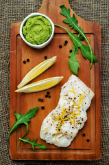 cod baked with lemon and spices with arugula and mashed green pe