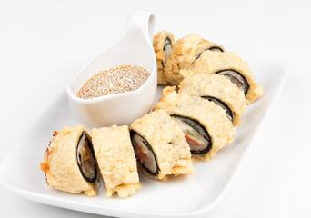 Close-up of Hot tempura sushi roll with tuna and salmon.