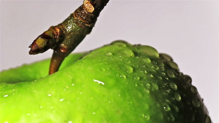 Rotating apple with water drops