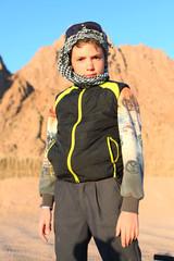 handsome preteen boy on safari trip in the egyptian desert
