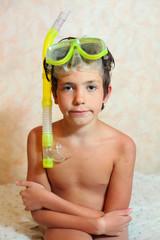 handsome preteen boy with snorkeling mask and tube