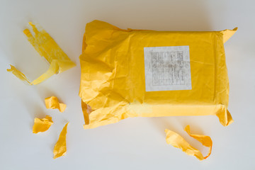 Opening yellow parcel from China.