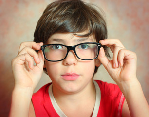 handsome preteen boy with correction myopia glasses