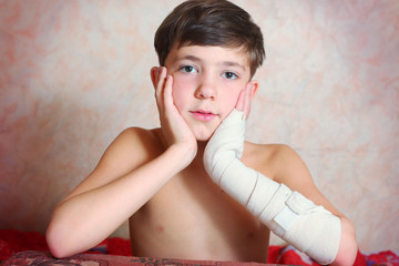 handsome preteen boy with hand in bandage