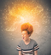 Young woman with energetic exploding red hair
