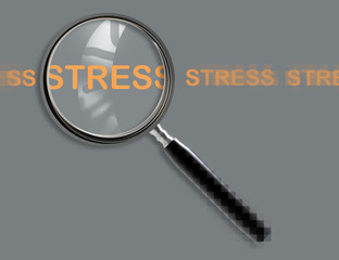 Close up of magnifying glass on stress