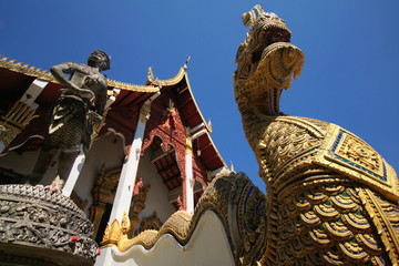 Thai ancient temple with fine carvings and King of Nagas