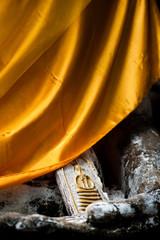 Buddha statue holding small Buddha statue