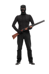Masked terrorist holding a shotgun