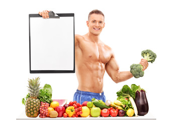 Athlete holding a broccoli dumbbell and a clipboard