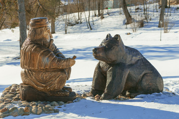 "Wooden sculpture ""Man and the bear"""