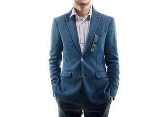 Man in trendy suit  standing alone with his hands the pockets