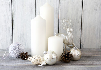 White candles with and Christmas balls, decor deer