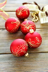 Christmas balls with ribbon on wooden boards