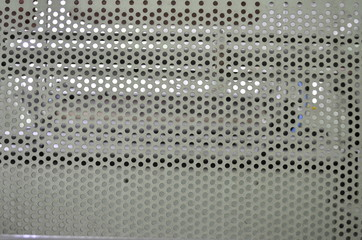 metal with round holes