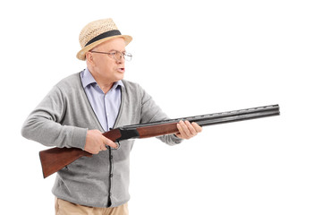 Angry senior holding a rifle
