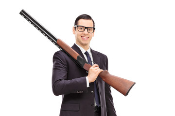 Businessman holding a rifle