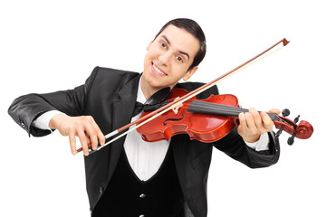 Cheerful violinist playing a violin