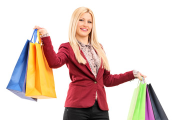 Elegant woman holding shopping bags