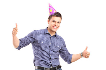 Guy with party hat giving thumbs up