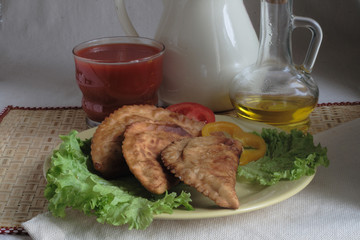 cheburek submitted with leaves of green salad and tomato juice