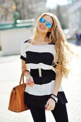 Beautiful blonde young woman wearing sunglasses
