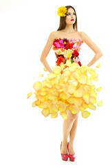 Beautiful young woman in dress made of flowers and flower
