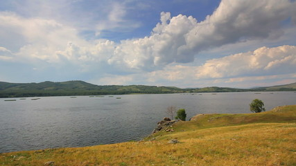 Beautiful timelapse landscape with lake between hills - South ur