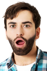 Young shocked man with mouth open.