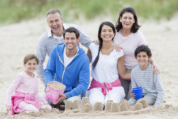 Multi-generation family smiling together on beach