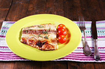 Dish of Pangasius fillet with rosemary and cherry tomatoes in
