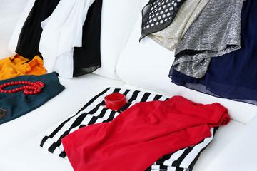 Messy clothing on white sofa background