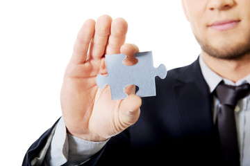 Businessman holding a puzzle.