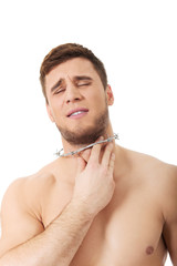 Young man with throat pain.