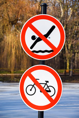Do not cycling and do not swimming signs
