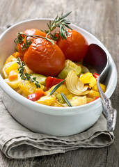 roasted vegetables in a white dish