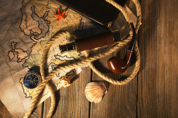 Marine still life spyglass and world map on wooden background