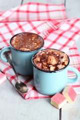 Mugs of hot coffee with marshmallow